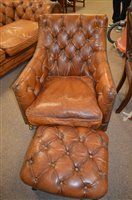 Lot 1086 - leather armchair and stool