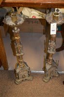 Lot 1048 - Pair of religious candlesticks