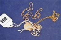 Lot 304-Gold pendant and yellow metal pendants and chains