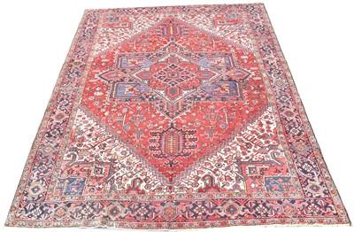 Lot 693 - Heriz carpet, with bold geometric design, 297...