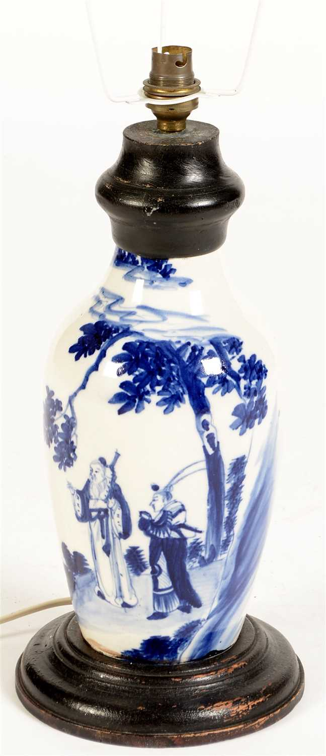 Lot 7-A Chinese blue and white baluster vase, later fitted as a lamp.