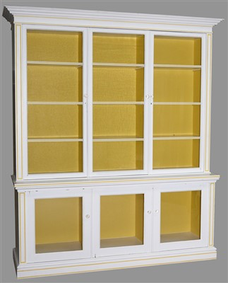 Lot 768 - A large white painted display cabinet.