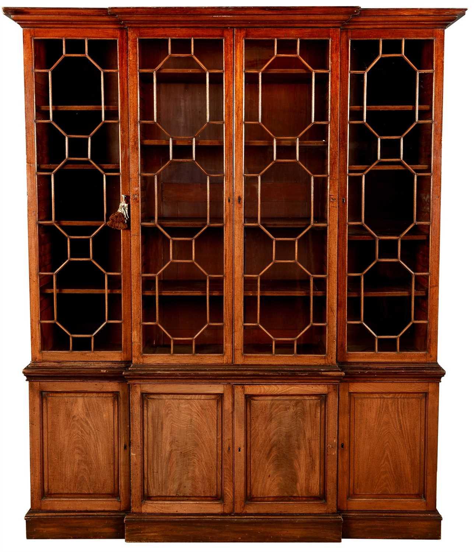 773 - A 19th Century mahogany breakfront bookcase.