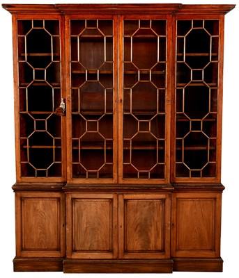 Lot 773 - A 19th Century mahogany breakfront bookcase.