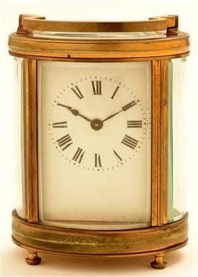 Lot 741 - An oval brass carriage clock, c1900