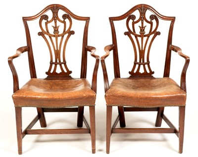 Lot 756 - A near identical pair of George III mahogany armchairs.