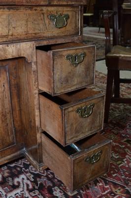Lot 841 - A walnut kneehole desk.