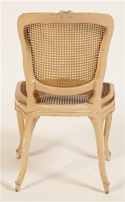 Lot 832 - A set of twelve George III parcel gilt side chairs in the Louis XV style.