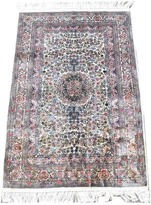 Lot 728 - Silk rug