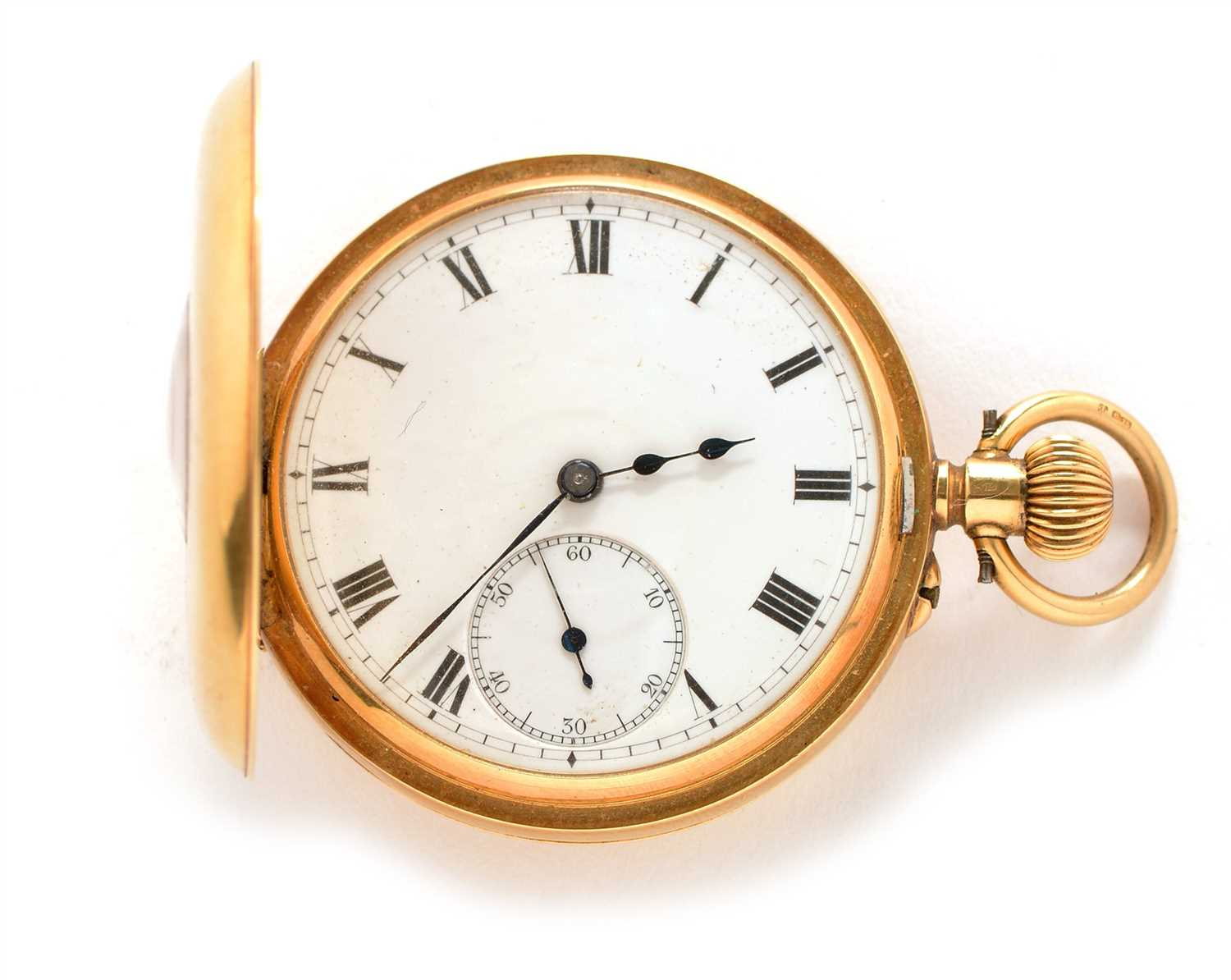 Lot 7-An 18ct. gold half hunter crown wind pocket watch.