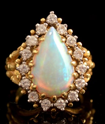 Lot 75-Opal and diamond ring