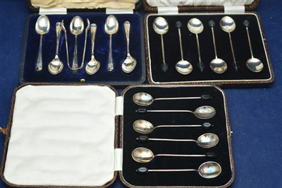 Lot 10-Silver coffee spoons and plated sugar tongs