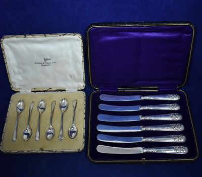 Lot 70-Silver handled knives and silver coffee spoons
