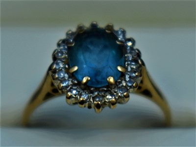 Lot 5-Topaz and diamond ring