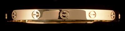 Lot 67A-Cartier rose gold 'Love' bangle.