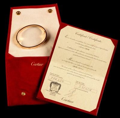 Lot 67-Cartier rose gold 'Love' bangle.