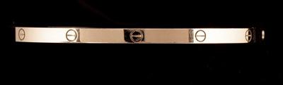 Lot 67B-Cartier white gold 'Love' bangle.