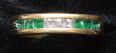 Lot 67-Emerald and diamond ring