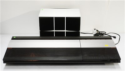 Lot 58 - A Bang and Olufsen Beocentre turntable and tech deck; and a pair of Beobox speakers.