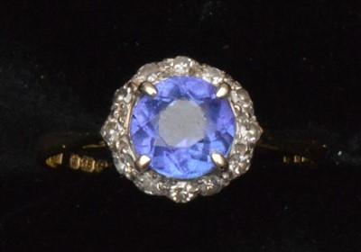 Lot 73-Tanzanite and diamond cluster ring