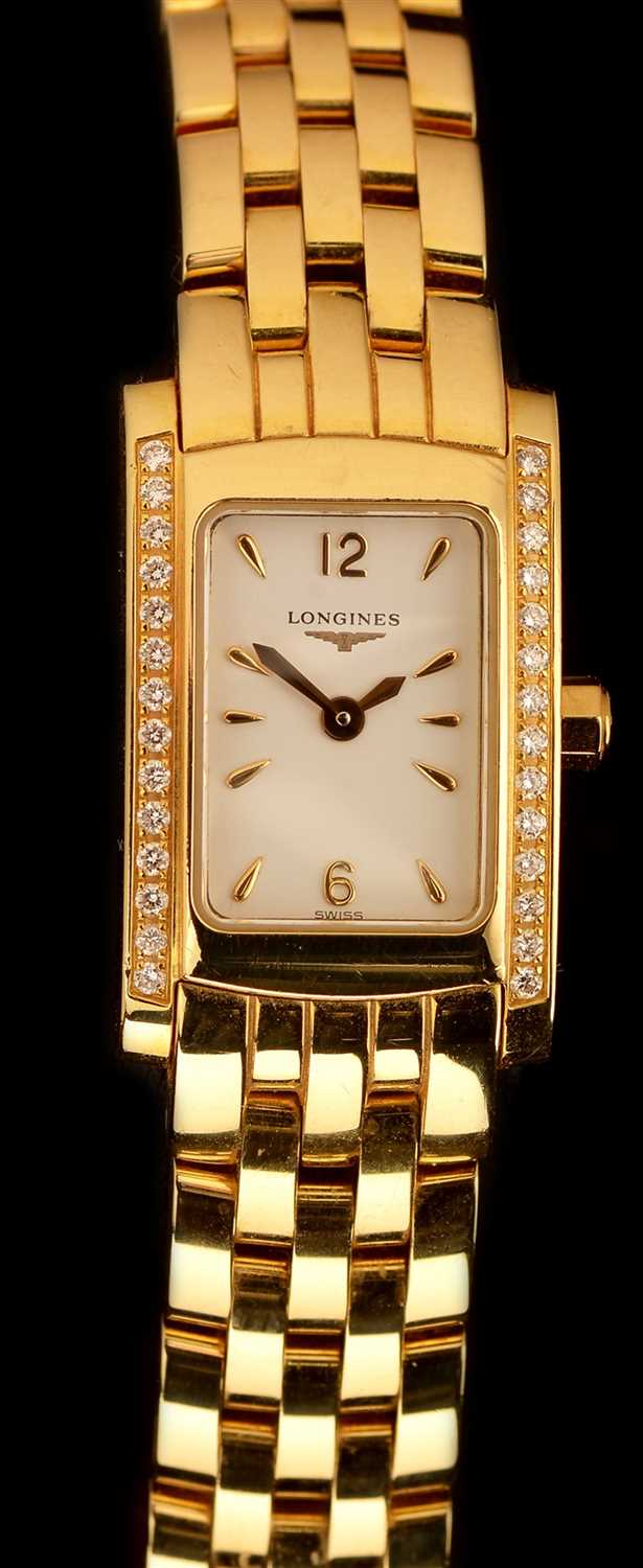 Lot 20-Longines 18ct Gold lady's watch with diamond bezel