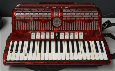 Lot 86 - An Elka 120 bass piano accordion.