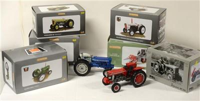 Lot 1320 - Die-cast model tractors by Universal Hobbies.