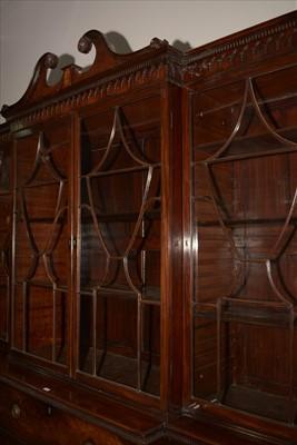 Lot 1226 - A George III mahogany breakfront secretaire bookcase.