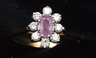 Lot 82-Pink sapphire and diamond ring