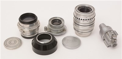 Lot 1434-Three lenses, various; and a viewfinder.
