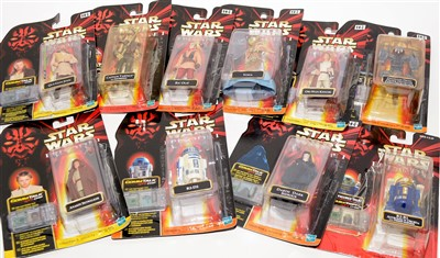 Lot 1223-Star Wars figurines and a Commtalk reader.