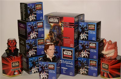 Lot 1225-Star Wars mugs and two statuettes.