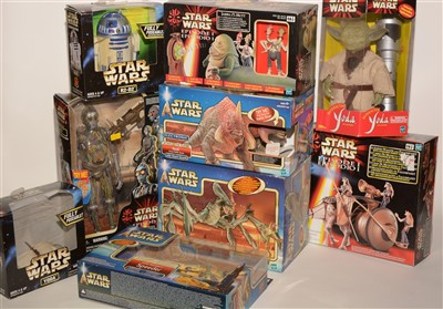 Lot 1239 - Star Wars figurines and robots.