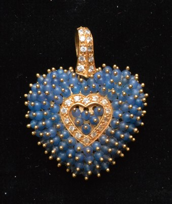 Lot 74-A sapphire and white sapphire pendant