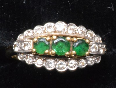 Lot 66-Emerald and diamond ring