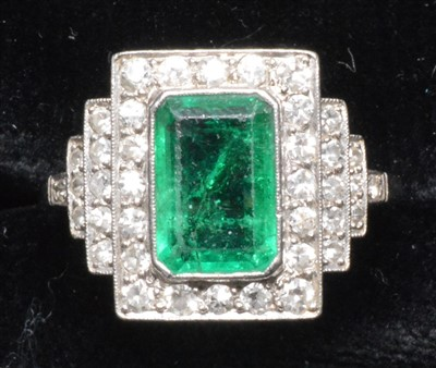 Lot 68-Emerald and diamond ring