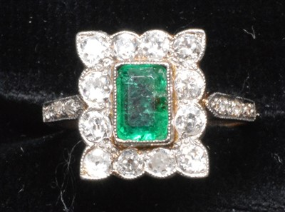 Lot 64-Emerald and diamond ring