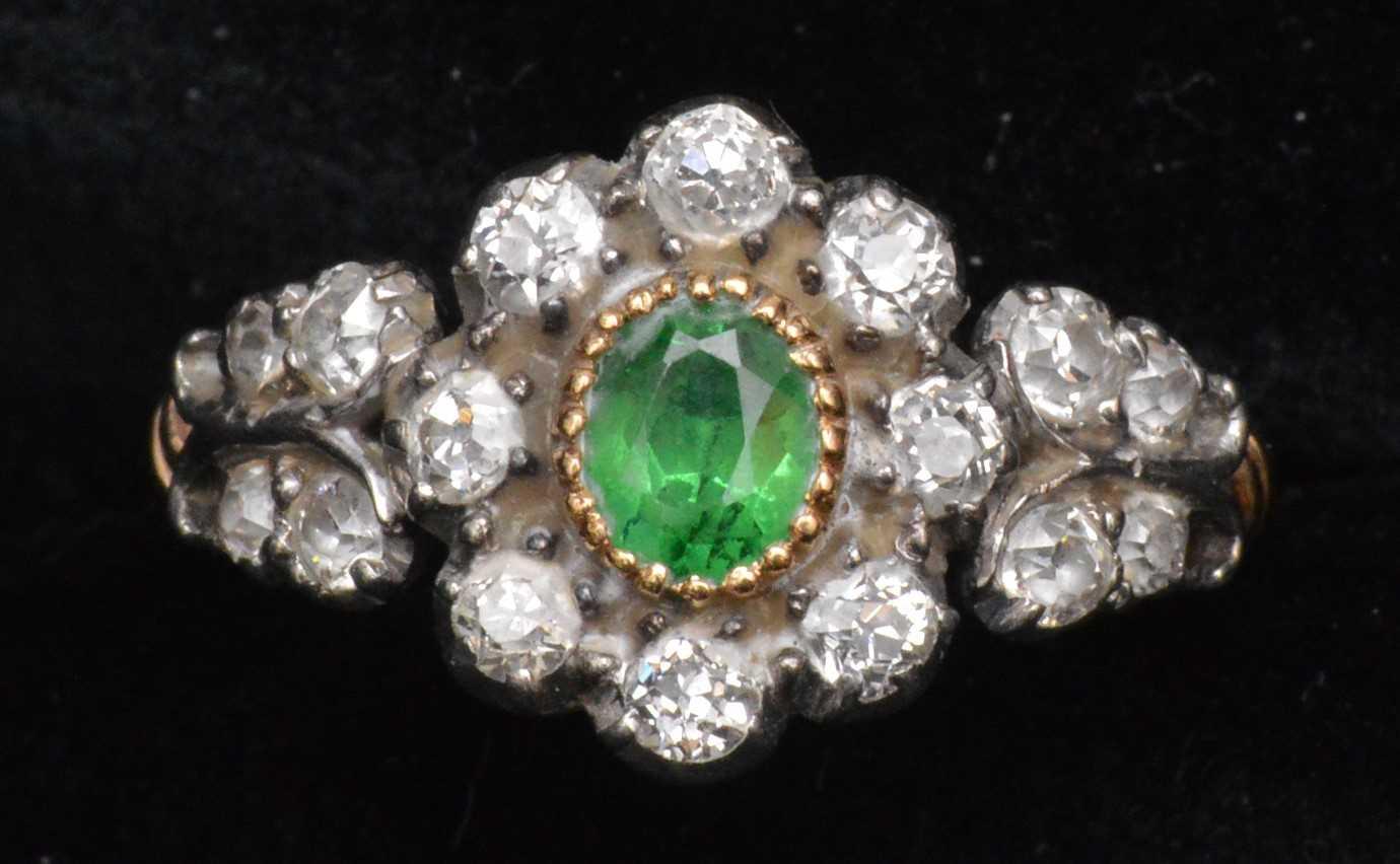 105 - Tsavoriate garnet and diamond ring