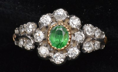 Lot 105-Tsavoriate garnet and diamond ring