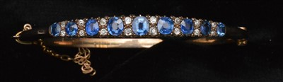 Lot 78-Sapphire and diamond bangle
