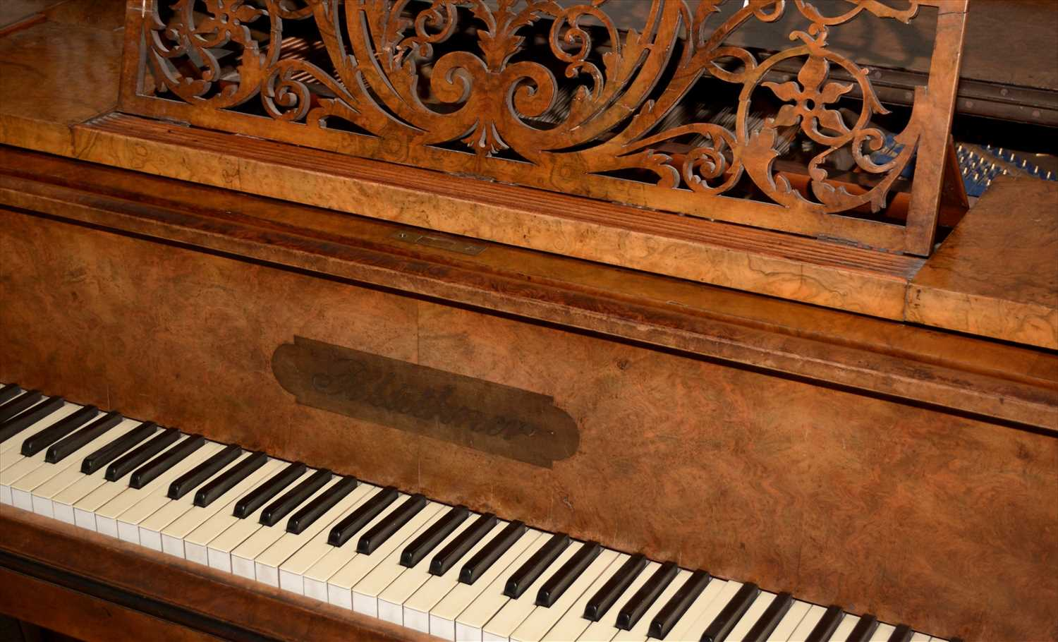 1000 - Bluthner: a Victorian walnut baby grand piano.
