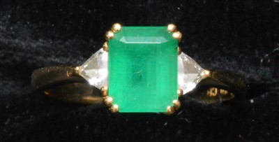 Lot 63-Emerald and diamond ring