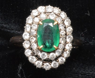 Lot 65-Emerald and diamond cluster ring