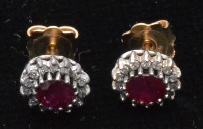 Lot 81-Ruby and diamond earrings