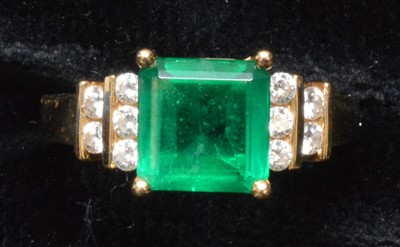 Lot 62-Emerald and diamond ring