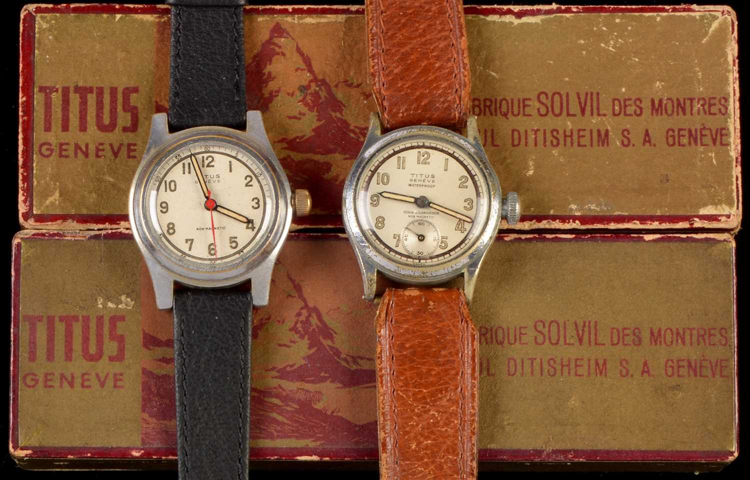 Lot 7-Two Titus Geneve stainless steel wristwatches.