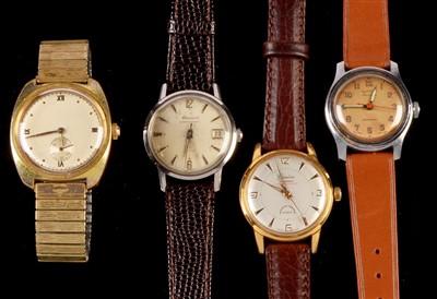Lot 8-Four vintage wristwatches.