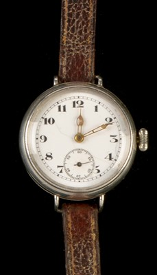 Lot 16-Of A.J.S. Motorcycle interest: a Record 022K silver trench watch.