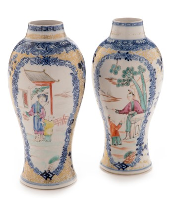 Lot 460-A near pair of Chinese 'soft paste' Famille Rose baluster vases.