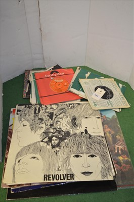 Lot 495-Beatles vinyl singles and LPs